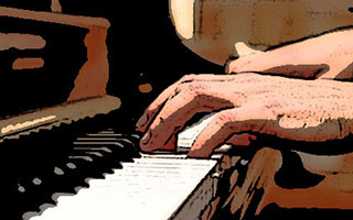 Closeup of hands playing piano